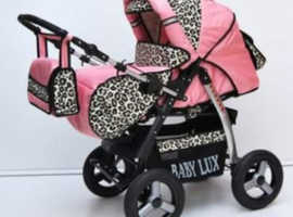 babyluxe pink and leopard print pram