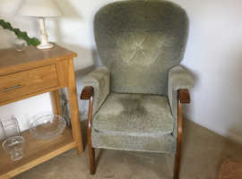 High armchair in green velour.