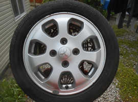 4 X  Factory Alloy Wheels for a 2008 Mitsubishi Colt CZ1 with center caps .