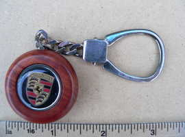 Porsche Silver Key ring with wooden mounted Porsche logo Quality item From Italy just right for Christmas Gift. Big Price Drop Bargain time.