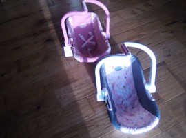 Two dolls car seats/carriers.