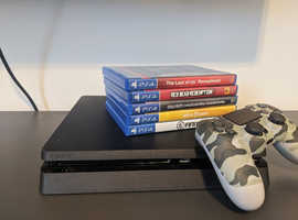 Sony PlayStation 4 Slim with 5 cool games