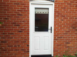 External door with glass panel.