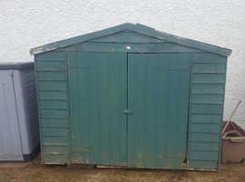 "Hut -Wooden garden hut 65""H; 204""W ;33"" D"
