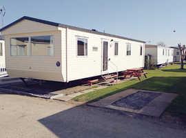 Luxury 3 bedroom caravan sleeping 8 people. On award winning Robin Hood nr Prestatyn Short Breaks from only £149