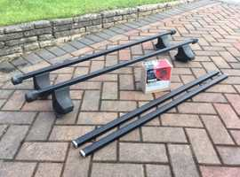 Thule square steel roof bars with feet and locks to fit Peugeot 306. £50.