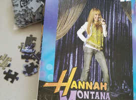 NEW/sealed 100 piece puzzle - ['Hannah Montana'  not on completed puzzle, just popstar on stage]