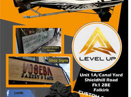 Level Up the quality service of SIGNS BANNERS DECALS WRAPING TINTING DETAILING CAR WASH