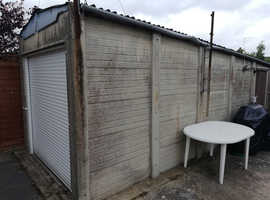 FREE sectional concrete garage with working electric garage door