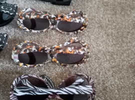 29 pairs of sunglasses