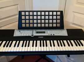 Yamaha Poratone PSR E203 Electric Keyboard, very good condition,  with adjustable stand, seat and original handbook/maunual