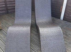 2 brown rattan loungers
