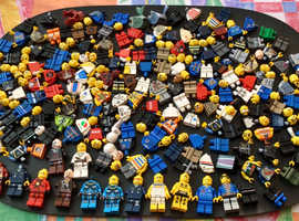 Over 280 Lego minifigure heads, torso's, legs, heads, hats etc.
