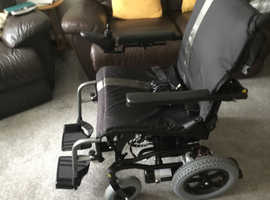Karma electric wheel chair with daul controle