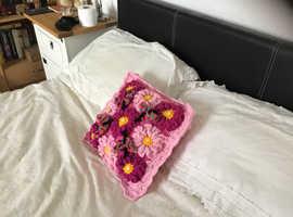 Handmade crocheted square cushion