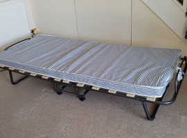 brand new fold down bed, never used.