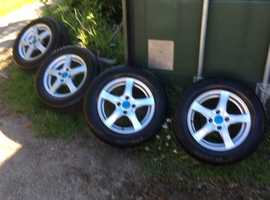 Set of 4 unmarked 15 inch alloy wheels
