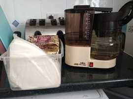 Filter coffee machine with lots of extra filters and coffee packets