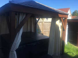 Hot tub and gazebo with roof top lights and curtains