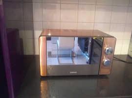 Copper colour microwave