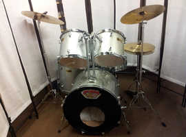 Retired drum teacher has several student drum kits with upgraded cymbals for sale from £200.