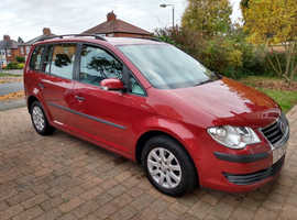 Smart Red Volkswagen Touran multi purpose vehicle