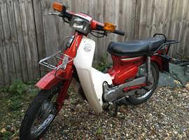 Classic Honda C90 Cub in flagship Red in good condition.