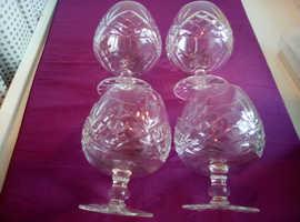 Four cut glass balloon brandy glasses