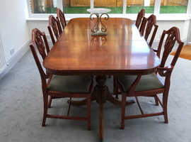 Extending wooden dining table with chairs