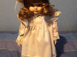A doll on a stand for sale