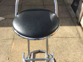 2 black and chrome bar stools