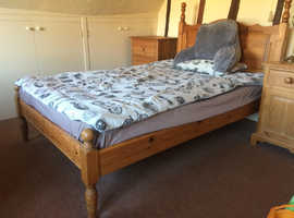 Double bed with pine headboard and frame, and firm mattress. VERY comfortable.