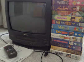 Sharp 14in screen TV with built in VHS - free videos included