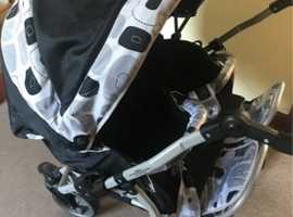 Double twin pram with newborn carry cot inserts