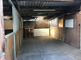 Private Barn with two internal stables & lockable room to rent.