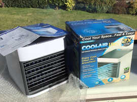 New in box. Portable air cooler, humidifier and purifier
