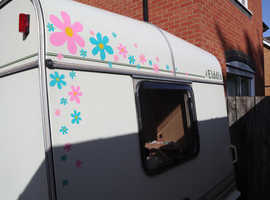 Pretty little 2 berth caravan with full awning