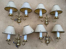 Four wall lights brass finish with candle bulb supports plus's shades