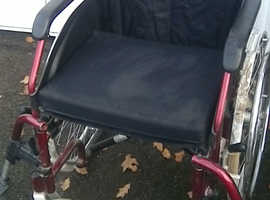 Second hand folding wheelchair in good condition/but perished tyres