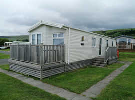 Sited static caravan with decking