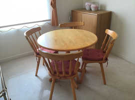 Small good quality polished pine table and chairs.