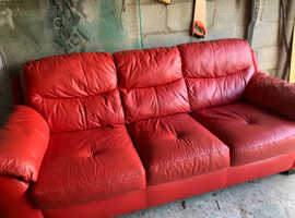 Red three seater settee