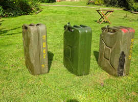 Three Jerry cans.