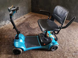 Mobility scooter foldable with electric battery charger