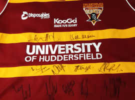 Signed Huddersfield Giant's replica shirt .
