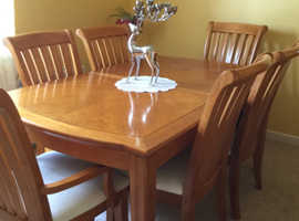Dining table with 6 chairs, dresser and mirror