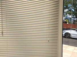 White narrow slatted aluminium venetian blinds