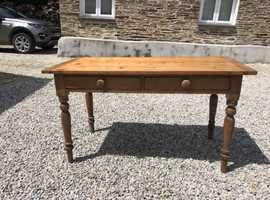 lovely kitchen table and 2 drawers.