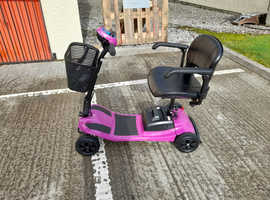 Pink preowned mobility scooter