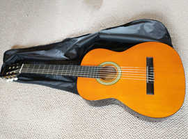 Junior 1/2 guitar with sleeve and sling, as new